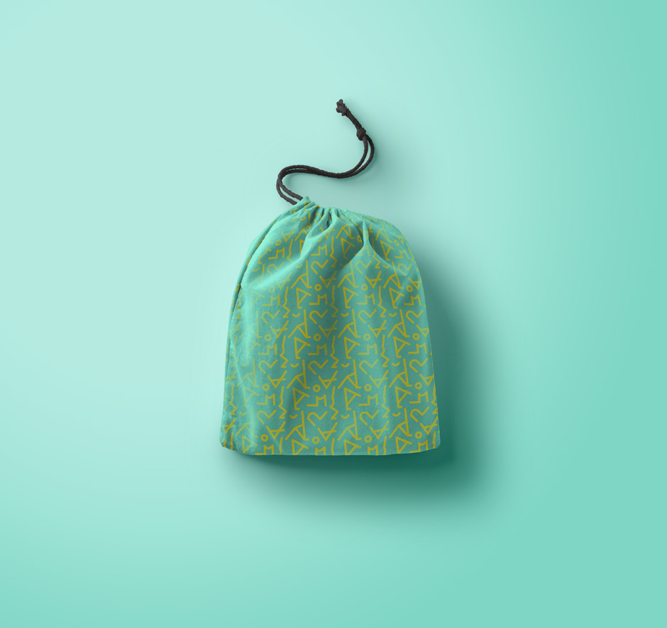 branding on green bag with yellow catcow yoga pattern