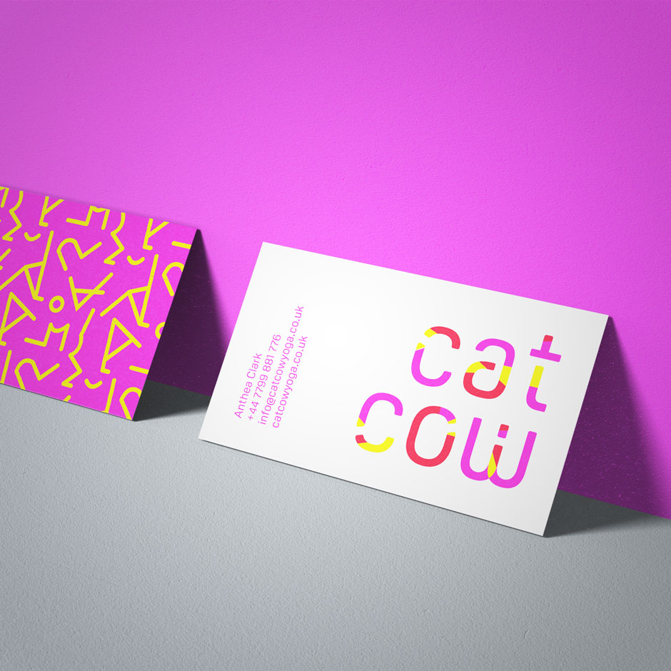 catcow yoga branding applied to business card against pink wall