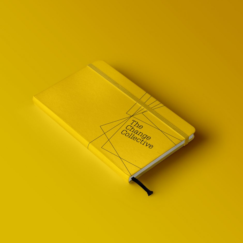 the change collective yellow branded notebook